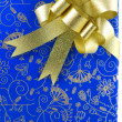 Stock Photo: Blue gift box with golden ribbon