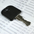 A key on account passbook — Stock Photo