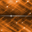 Photo: Orange background with star glitter abstract