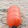 Stock Photo: Orange buoy on the beach