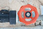 Orange water valve and steel pipe — Stock Photo