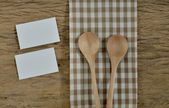 Blank notepad with utensils on a wooden surface — Stock Photo