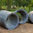 Stock Photo: Concrete sewage pipes under construction