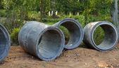 Concrete sewage pipes under construction — Stock Photo