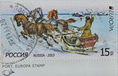 Russia postage stamp shows post vehicles — Stock Photo