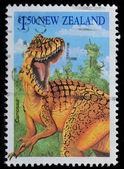 ニュージーランドの切手は 1993 年頃の carnosaur を示しています — ストック写真