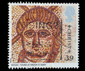 Great Britain postage stamp shows Mosaic of Christ Roman Artifac — Stock Photo