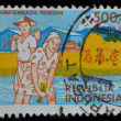 Indonesia postage stamp shows farmers working at paddy fields — Stock Photo