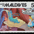 Maldives postage stamp shows Alice in wonderland — Stock Photo