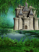 Fairytale castle by the river — Stock Photo