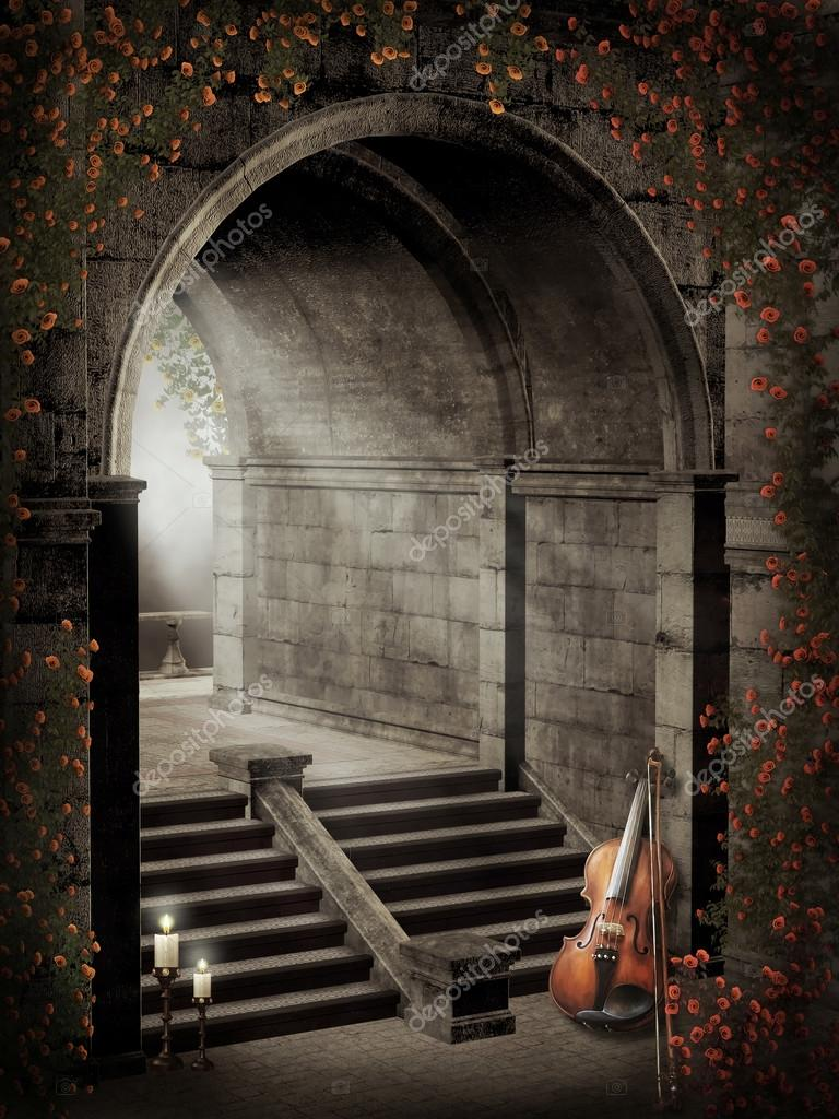Gothic gate with roses, candles and violin  Stock Photo #12856730