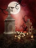 Creepy tombs with skulls — Stock Photo