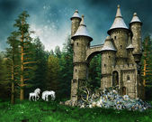 Castle and unicorns on a meadow — Stock Photo
