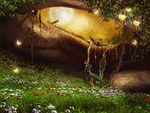 Grotte enchantée avec fleurs — Photo