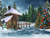 Christmas cottage with a snowman — Stock Photo