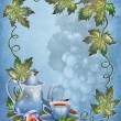 Blue background with leaves and tea cup - Stock Photo
