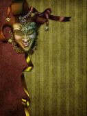 Fond de carnaval avec un masque — Photo