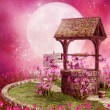 Old well in a pink scenery — Stock Photo