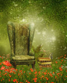 Armchair and books on a meadow — Stock Photo