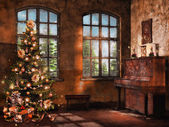 Room with a piano and Christmas tree — Stock Photo
