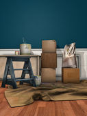 Carton boxes, paint cans and a ladder — Stock Photo