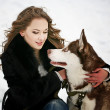 Stock Photo: Womwith dog in snow