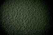 Grunge grained dark green wall background or texture — Stock Photo
