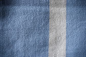 Grunge blue and white striped polo shirt background or texture — Stock Photo
