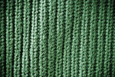 Green regular striped and woven material background or texture — Stock Photo