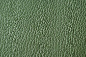 Green synthetic leather texture or background — Stock Photo