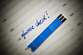 Stripes for glucose test, reminding note in personal organiser. — Foto Stock