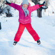 Little girl playing in the snow — Stock Photo #36937343