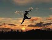 Женщина, прыжки на рассвете — Стоковое фото