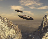 Flying saucers over mountains — Stock Photo