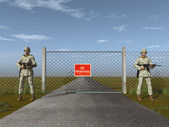 Soldiers standing guard in front of a gate — Stock Photo