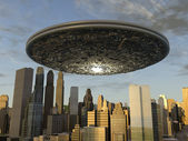 Large UFO over a city — Stock Photo