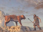 Caveman and Saber Tooth Tiger — Stock Photo