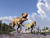 Tyrannosaurus rex chasing a velociraptor — Stock Photo