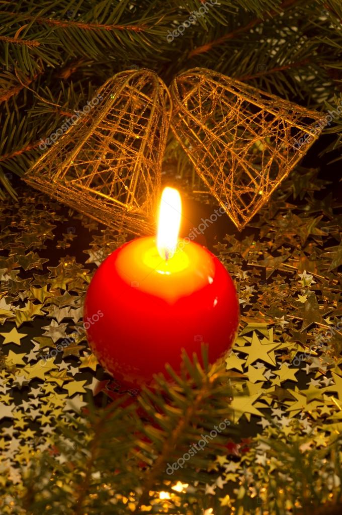 Red, spherical candle and bells, fir branches, stars — Stock Photo #14492939