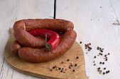 Sausage, peppercorns and chili — Stock Photo