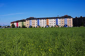 New apartment blocks surrounded by green fields — Stock Photo