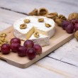 Cheese, walnuts, grapes — Stock fotografie #35194145