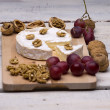 Foto de Stock  : Cheese, walnuts, grapes