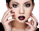 Beautiful woman in bright makeup — Stock Photo