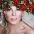 Beautiful blonde girl in wreath — Stock Photo #15454907