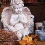 Angel figurine still life in autumn leaves — Stock Photo #15546889