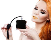 Beautiful woman with perfume — Stock Photo