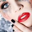 Face of a beautiful woman in a fancy makeup up close — Stock Photo