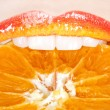 Beautiful and tasty orange lips - Stock Photo