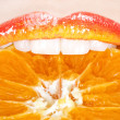Beautiful and tasty orange lips — Stock Photo